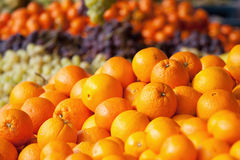 Oranges. Pile of oranges at a market stall Royalty Free Stock Photos