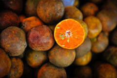 Oranges. Pile of oranges with one half cut Royalty Free Stock Photo