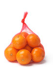 Oranges in Plastic Mesh Sack. Fresh Oranges in Plastic Mesh Sack on White Background Royalty Free Stock Image