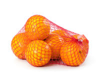 Oranges in plastic mesh sack. On white background Stock Photography