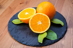 Oranges. On a Plate stone Royalty Free Stock Image