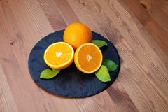 Oranges. On a Plate stone Stock Image
