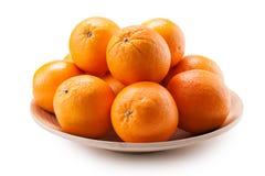 Oranges on platter close-up isolated on white background Stock Photography