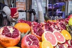 Oranges and pomegranates Stock Photography