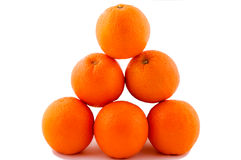 Oranges pyramide. On the white Stock Photos