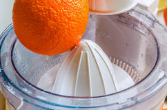 Oranges with Reamer juicer Royalty Free Stock Images