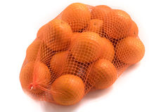 Oranges in red net isolated. On white close up Royalty Free Stock Images