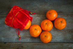 Oranges with a Red Pouch Royalty Free Stock Images