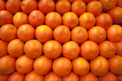 Oranges in a row. Fresh stacked oranges at farmer's stand Stock Photography