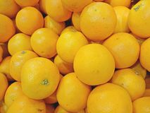 Oranges on sale. At night market in Singapore . Shallow DOF stock photography