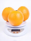 Oranges on scale royalty free stock images