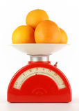 Oranges on a scale Royalty Free Stock Photos