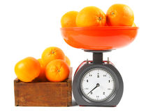 Oranges on scales and in a box Stock Image