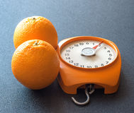 Oranges and scales. Two orange and orange scales Stock Image