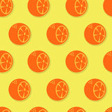 Oranges seamless pattern. Orange slices on yellowl background Royalty Free Stock Images
