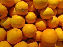 Oranges on shelf. Group of orange on display shelf in market stock photo