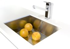 Oranges in the sink Royalty Free Stock Photography