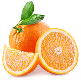 Oranges with slice and leaves isolated on a white background. Royalty Free Stock Image