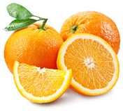 Oranges with slice and leaves isolated on a white background. Royalty Free Stock Photo