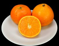 Oranges and a slice Royalty Free Stock Image
