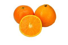 Oranges and a slice Royalty Free Stock Photography