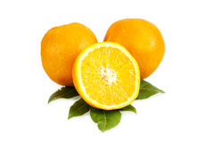 Oranges. Sliced oranges over a white background Royalty Free Stock Photos