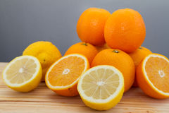 Oranges and slices with chrome citrus juicer Royalty Free Stock Photo