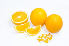 Oranges with slices Royalty Free Stock Images