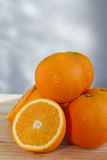 Oranges and slices Royalty Free Stock Image