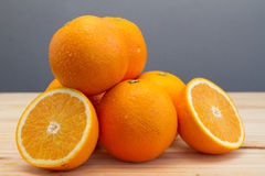 Oranges and slices Stock Photos