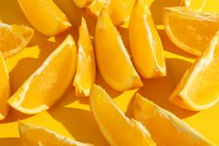 Oranges slices on a yellow background, bright pattern wallpaper stock photos