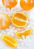 Oranges  on the snow Stock Photos