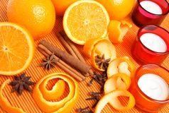 Oranges, spices and candles stock image