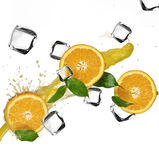 Oranges with splashing juice Royalty Free Stock Photo