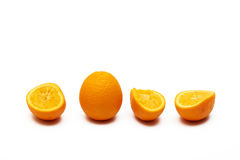 Oranges. Squeezed oranges halves and one full orange Stock Image