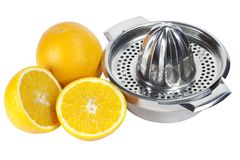 Oranges and squeezer Royalty Free Stock Photography