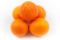 Oranges stacked as pyramid Stock Photography