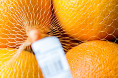 Oranges in a supermarket with a barcode Stock Image