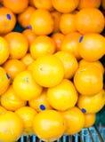 Oranges in supermarket cart Stock Photo