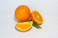 Oranges. Sweet orange fruit with leaves on white royalty free stock photos