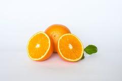 Oranges. Sweet orange fruit with leaves on white stock photo