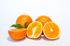 Oranges. Sweet orange fruit with leaves on white Royalty Free Stock Image