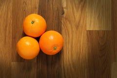 Oranges on table Stock Photos