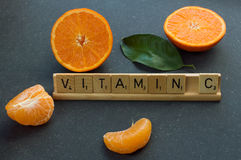 Oranges. On a table. Vitamin c written in scrabble letters Royalty Free Stock Photo