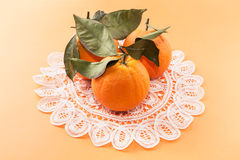 Oranges on tablecloth Stock Image