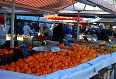 Oranges and tangerines in the fruit market. On the shelves of the fruit market are tangerines and oranges Royalty Free Stock Photo