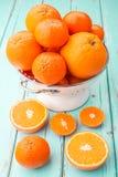Oranges and Tangerines in retro colander. Stock Photography