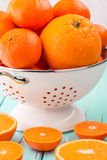 Oranges and Tangerines in retro colander. Stock Images