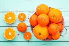 Oranges and Tangerines in retro colander. Stock Photo