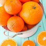 Oranges and Tangerines in retro colander. Royalty Free Stock Photo